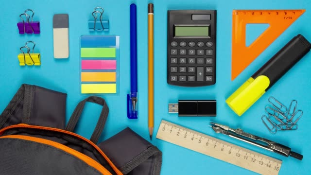 Stop motion animation. School supplies and school bag.