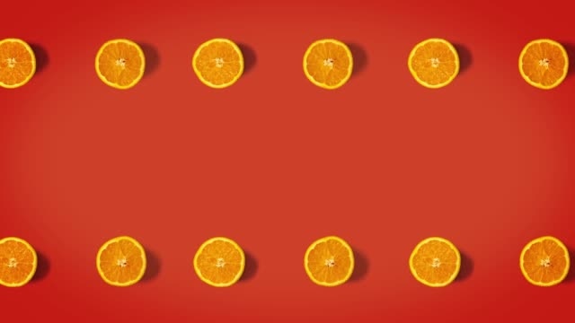 Stop motion animation top view on oranges rotating over a vintage orange background