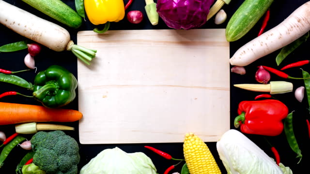 stop motion animation top view vegetables and wood background for copy space - bell pepper stock videos & royalty-free footage