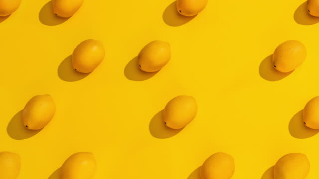 stop motion collection of lemons on a yellow background. - still life stock videos & royalty-free footage