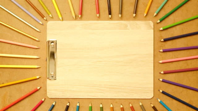 stop motion color pencil on wood backgroud , 4k video - colored pencil stock videos and b-roll footage