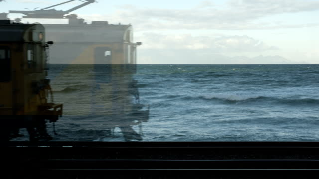 stop motion commuter train, im mist cape town, south africa - commuter train stock videos & royalty-free footage