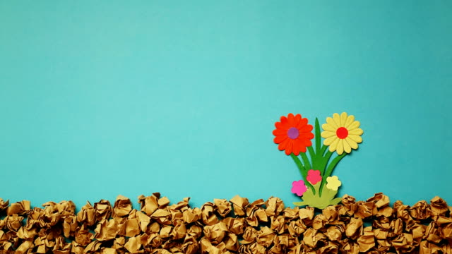 stop motion flower growing with paper cut , 4k video - growth stock videos & royalty-free footage