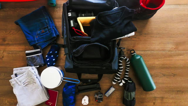 vídeos de stock e filmes b-roll de stop motion footage packing the backpack getting ready to going for a travel. - acampar