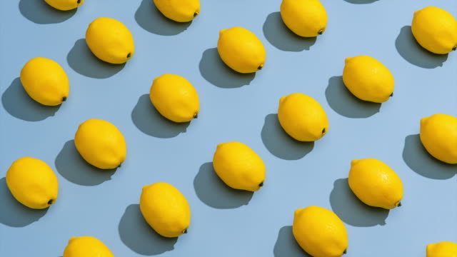 stop motion  of lemons on a blue background. - juicy stock videos & royalty-free footage
