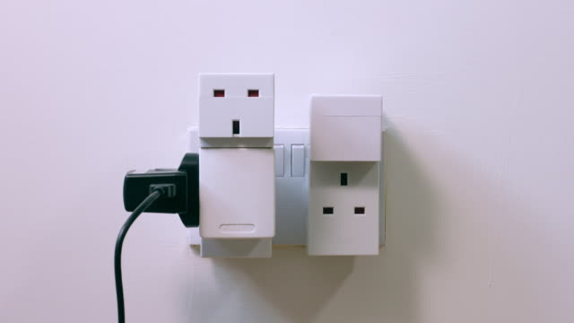 stop motion. overloaded power socket. - electrical plug stock videos & royalty-free footage
