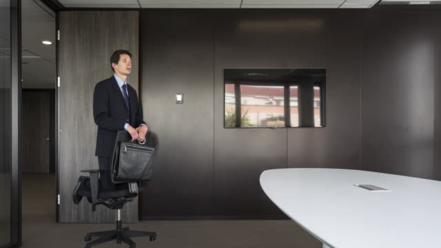 Stop motion shot of Businessman entering room on a rolling chair