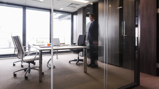Stop motion shot of Businessman sliding and turning like a pinwheel while entering office