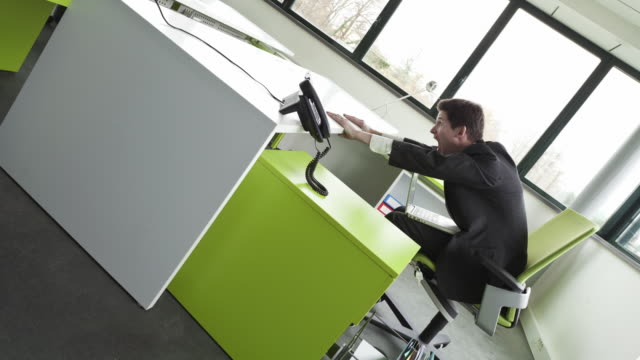 "stop motion shot of businessman sliding in a ""titanic "" office - chair stock videos & royalty-free footage"