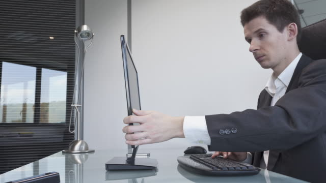 Stop Motion shot of businessman using his laptop as a typewriter