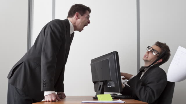 Stop Motion shot of employee agressed and blown away by boss's voice