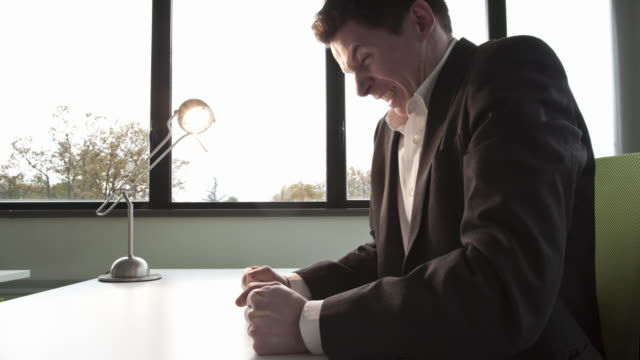 Stop Motion Track shot of businessman unable to keep his laptop close to him