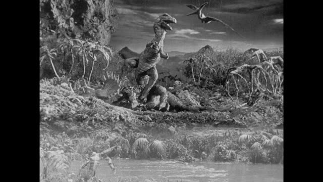 1925 stop motion t-rex snatches passing pterodactyl out of the sky - fangen stock-videos und b-roll-filmmaterial