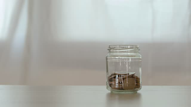 stop motion video of coin in glass bottle. - jar stock videos & royalty-free footage