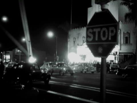 WS Stop sign and traffic in front of Carthay Circle Theater / Los Angeles, California, United States