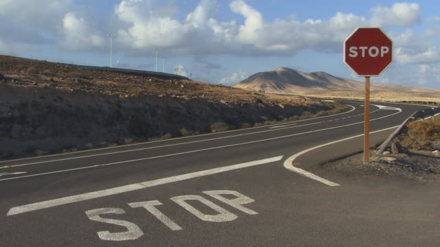 CU, ZO, stop sign by rural highway / Fuerteventura, Canary Islands, Spain
