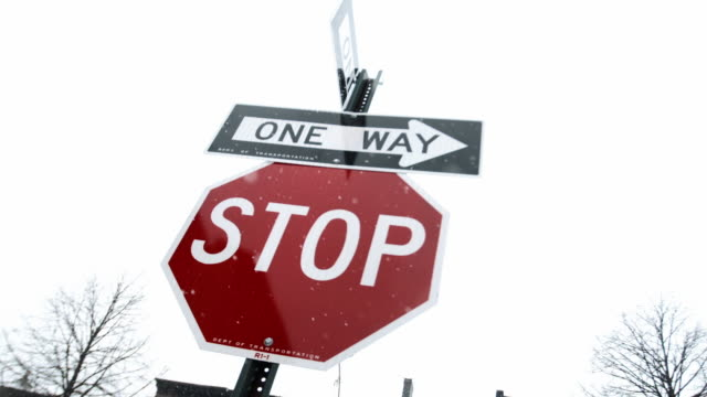 stop sign snow storm - road sign stock videos & royalty-free footage