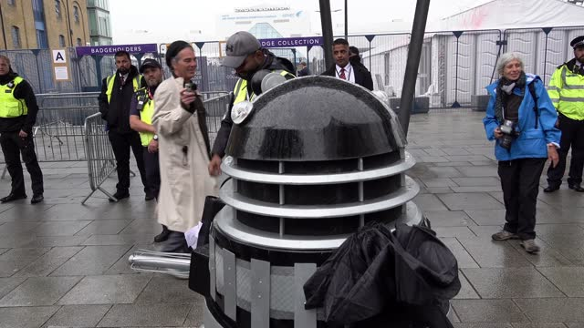 stop the arms fair protestor dressed as a dalek from the television series doctor who attempts to enter the defence security and equipment... - effort stock videos & royalty-free footage