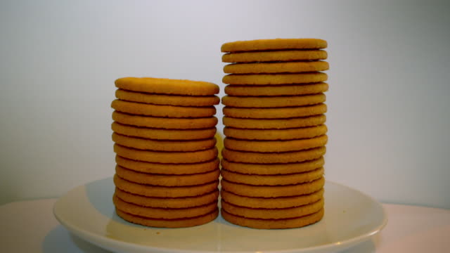 stop-motion sequence showing stacking biscuits - unhealthy eating stock videos & royalty-free footage