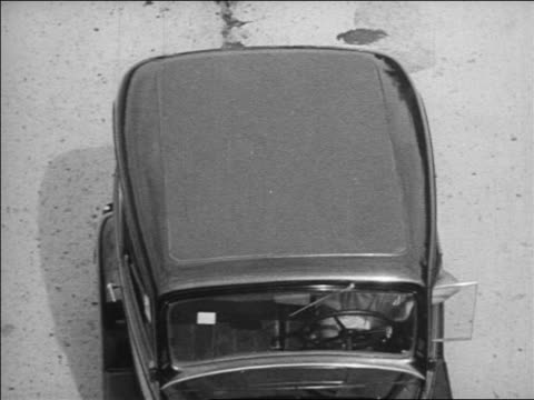 b/w 1934 overhead stopped car / industrial - anno 1934 video stock e b–roll
