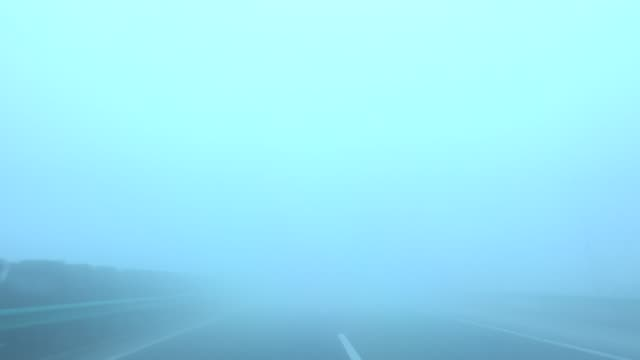 stopping to emergency parking strip in thick fog day - thick stock videos & royalty-free footage