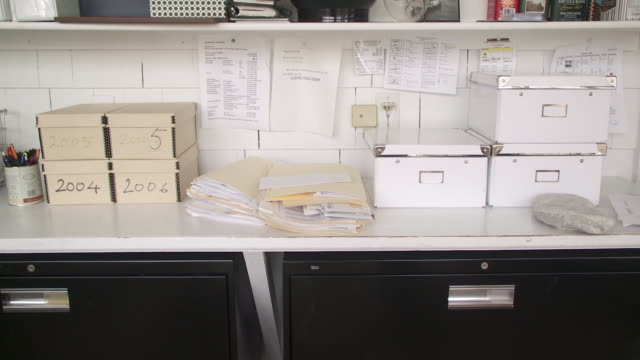 cu storage boxes and papers on desk in home office, scarborough, new york, usa - filing cabinet stock videos & royalty-free footage