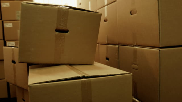 Storage room with heap of pasteboard boxes
