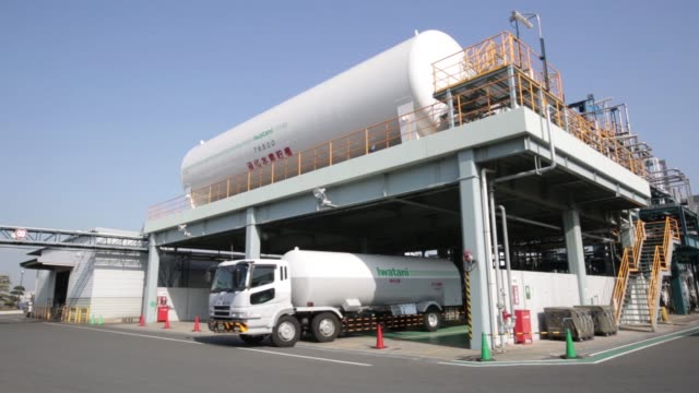 a storage tank sits atop a fuel depot at a liquid hydrogen plant operated by iwatani industrial gases corp a subsidiary of iwatani corp at the... - fuel storage tank stock videos and b-roll footage