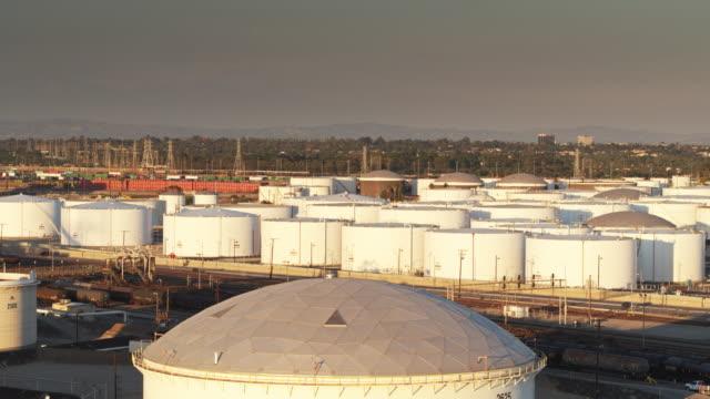 storage tanks at chemical plant - aerial shot - storage tank stock videos & royalty-free footage