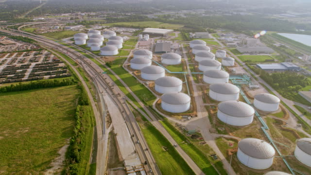 aerial storage tanks of an oil refinery in houston, tx - storage tank stock videos & royalty-free footage