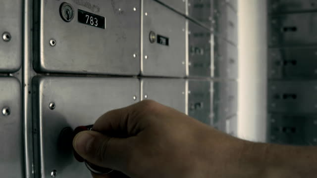 storage with safe lockers. taking a key from keyhole - mailbox stock videos and b-roll footage