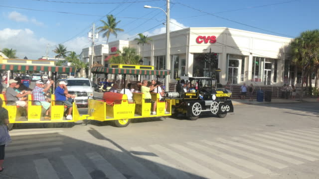 cvs store and tour bus in key west florida - cvs caremark stock videos and b-roll footage