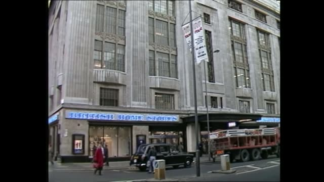BHS store chain goes into administration / Sir Philip Green potential contribution AS251185009 / British Home Stores shop as traffic passes People...