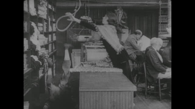 1917 store clerk (al st. john) is hit on head with basket while serving customer in butcher shop - 1910 stock videos and b-roll footage