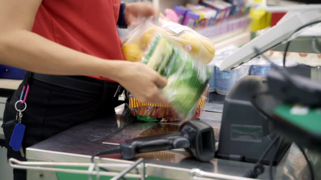 store clerk scanning barcode products at supermarket store. - receipt stock videos & royalty-free footage