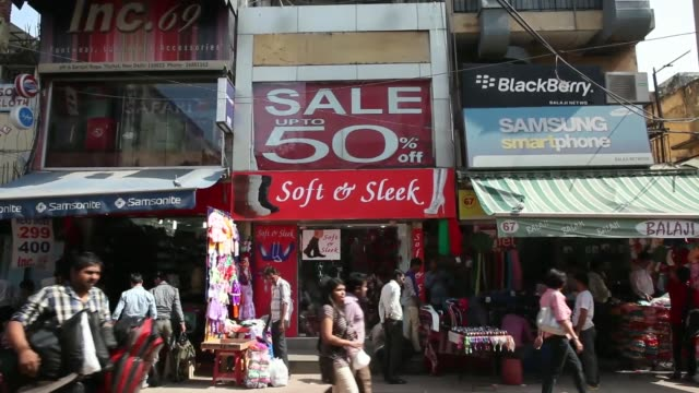 A store displays signage for Diwali sales in New Delhi India on Thursday Oct 31 Pedestrians walk by a sari store displaying signage for Diwali sales...