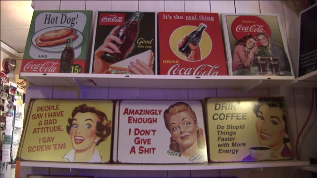 a store displays vintage advertising posters and signs. - poster stock videos & royalty-free footage