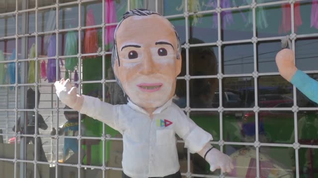 store in the northern mexican city of ciudad juarez that makes pinatas bearing the images of the presidential candidates says jose antonio meade of... - papier stock videos & royalty-free footage