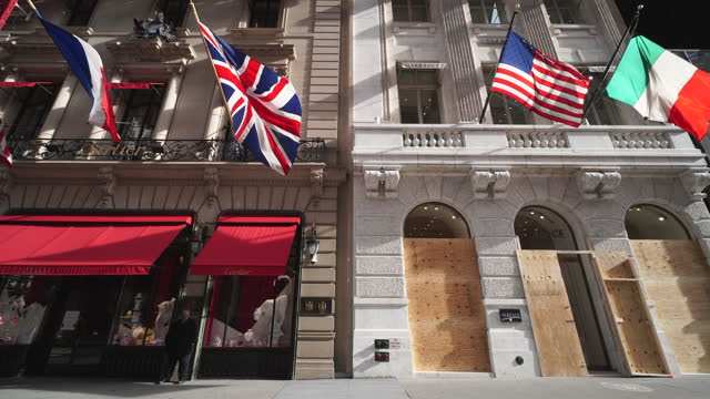 store on midtown fifth avenue new york city boarded up the store windows to prevent possibility of riot and mob violence for result of the... - french flag stock videos & royalty-free footage