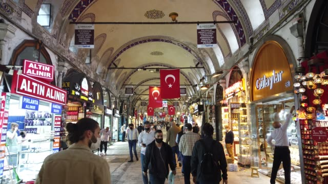 store owners clean their shops and stock in istanbul's famous grand bazaar after it reopened after being shut down for weeks due to the spread of the... - home economics点の映像素材/bロール