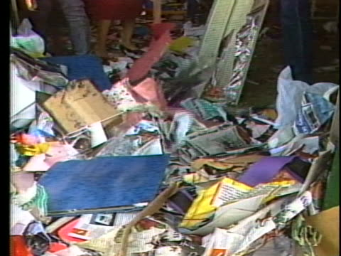 store owners clean up debris left after their store is looted - crime or recreational drug or prison or legal trial video stock e b–roll