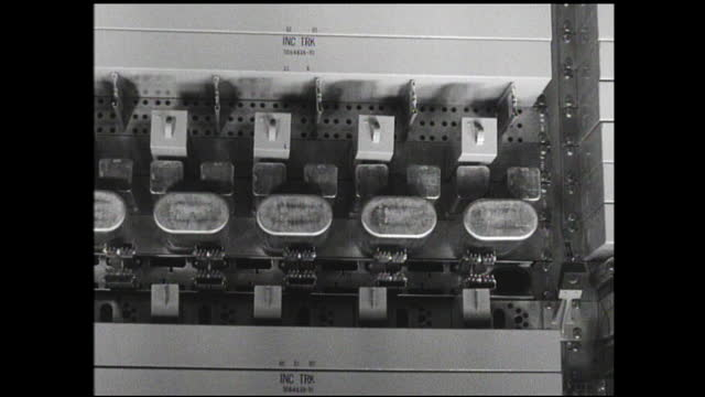 "store window with sign: ""western electric company general offices haverhill shops""; man working on something; panning view of various circuit boards - 1940 1949 stock videos & royalty-free footage"