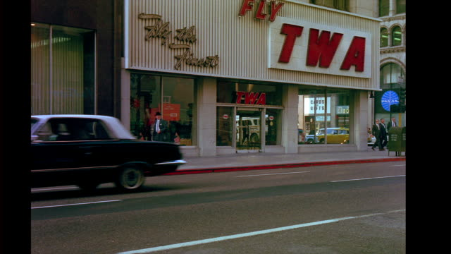 twa storefront office on city street corner outtakes from 'good neighbor sam' city street corner on october 22 1963 in san francisco california - twa video stock e b–roll
