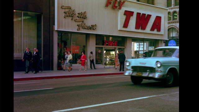twa storefront office on city street corner traffic passing by outtakes from 'good neighbor sam' city street corner on october 22 1963 in san... - twa video stock e b–roll