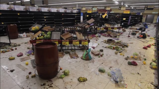 Stores in Nicaragua's capital stand virtually empty and in disarray following looting and panic buying after clashes in which two dozen people were...