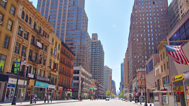 stores located in a new york quiet city street. manhattan. american flag. - facade stock videos & royalty-free footage