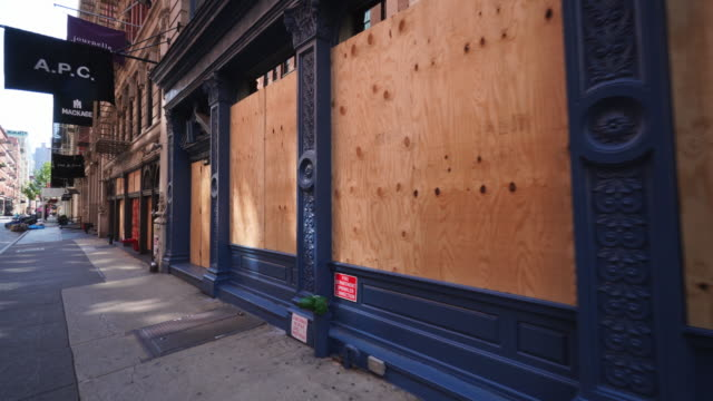 stores still have been boarded up and closed to protect against potential mob violence during george floyd death protests. - barricade stock videos & royalty-free footage