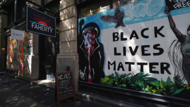 stores still have been boarded up to protect against potential mob violence during george floyd death protests - mural stock videos & royalty-free footage