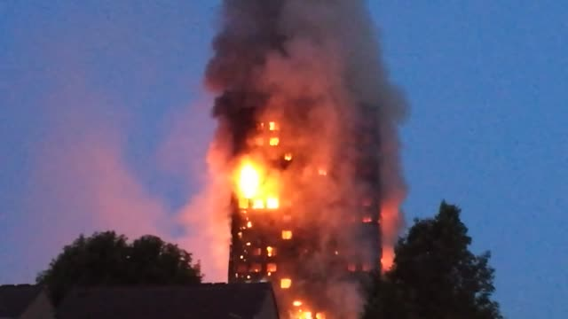 24 storey apartment building engulfed by huge blaze near nothing hill in london united kingdon on june 14 2017 the fire at grenfell tower on near... - fire natural phenomenon stock videos and b-roll footage