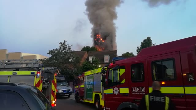 storey apartment building engulfed by huge blaze near nothing hill in london, united kingdon on june 14, 2017. london's senior fire fighter has said... - animal colour stock videos & royalty-free footage